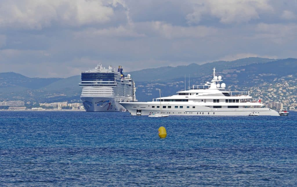 A picture of two massive yachts